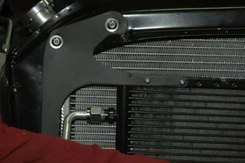 small resolution of  to mount the upper bracket and run them through matching holes into the bracket that holds vintage air condenser in place on the front of the radiator