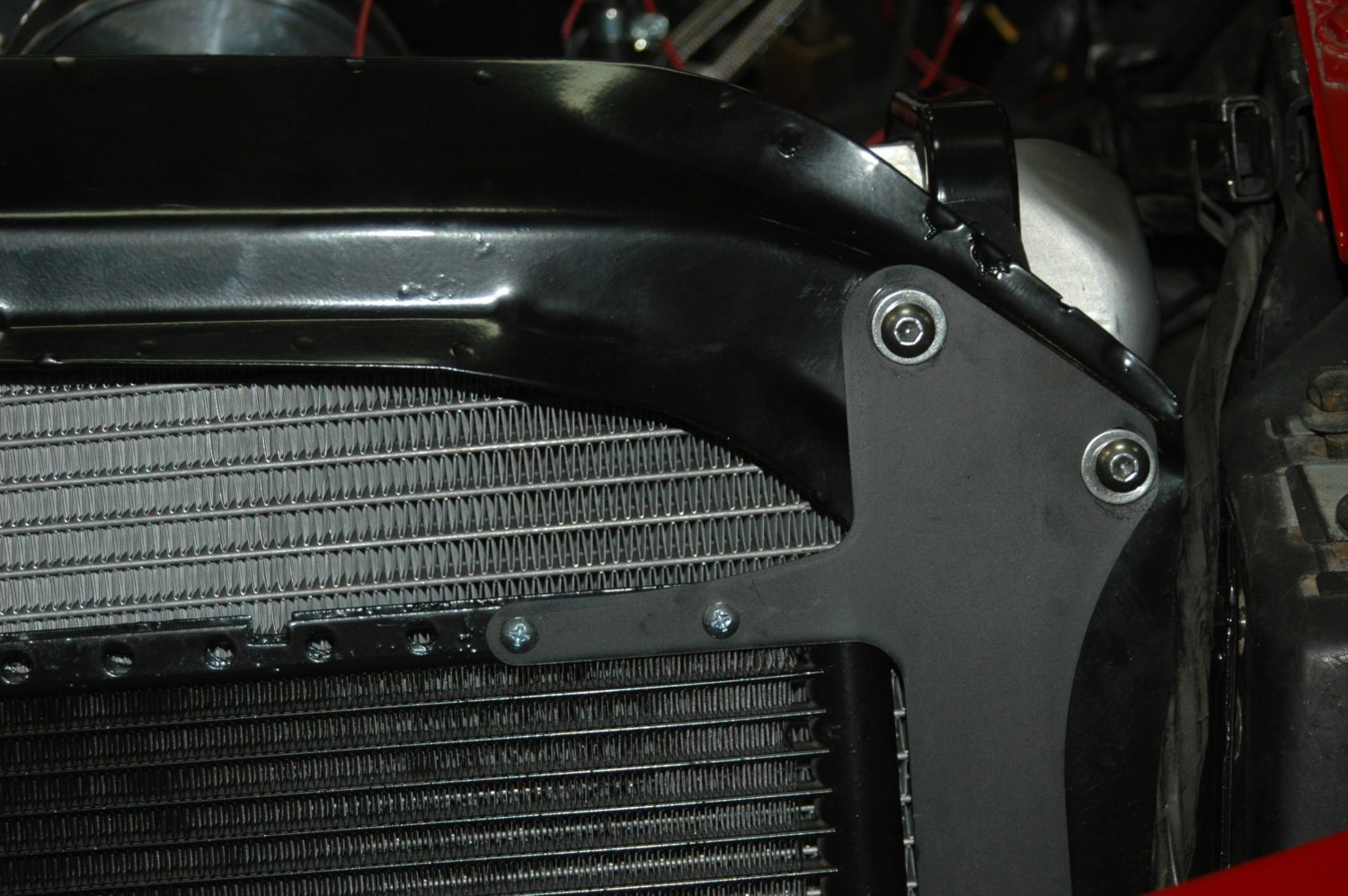 hight resolution of  to mount the upper bracket and run them through matching holes into the bracket that holds vintage air condenser in place on the front of the radiator