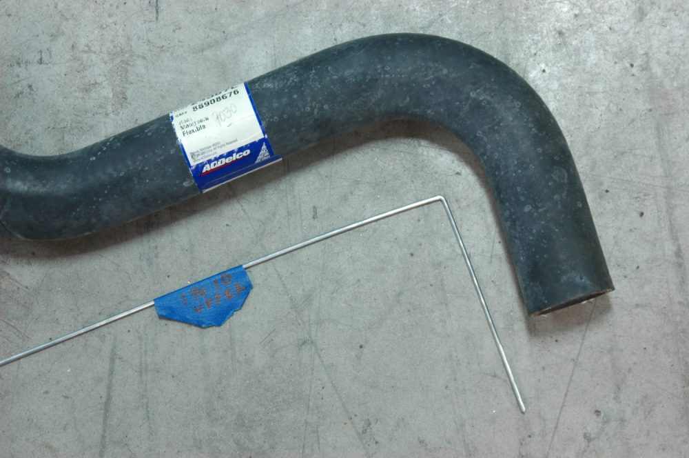 medium resolution of the upper radiator hose along with its bent wire