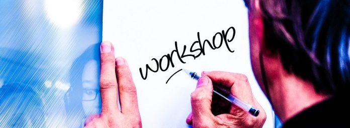 man-office-meeting-writing-sign-starbursting-ideation-brainstorming-workshop-tools-free-template