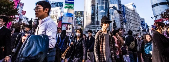downtown-japan-pedestrains-group-people-walking-urban-street-crossing-road-looking-camera-japanese