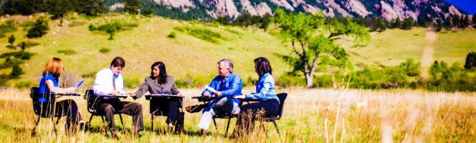 business meeting outside in nature open sky blue people diversity tips for better meetings crop