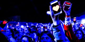 Crowd Concert Event Holding Up Lights Hearts Smartphones Special Olympics 2017