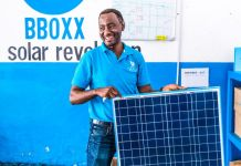 BBOXX Solar Panel Product Portfolio Battery Solutions West Africa Man Repairing Holding Sun Energy Renewable Power Venture