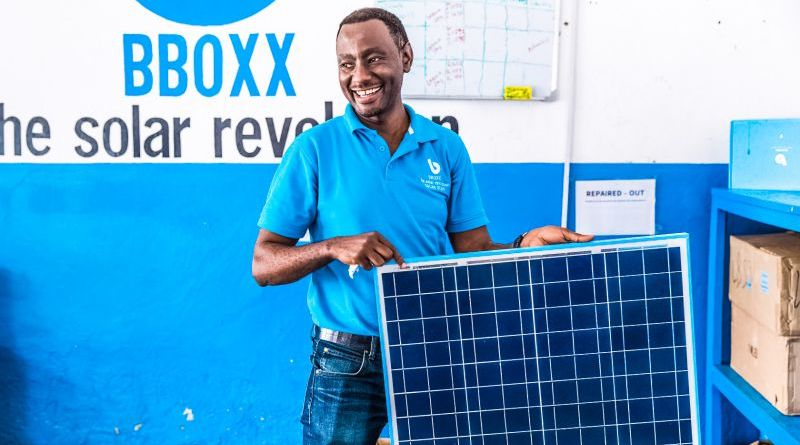 BBOXX Solar Panel Product Portfolio Battery Solutions West Africa Man Repairing Holding Sun Energy Renewable Power Venture