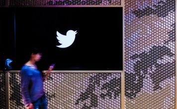 Twitter Office Meeting Room Video Conference Tokyo Japan Woman Tweeting Smartphone Walking Past Looking Device Blurry Motion Blur