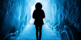 woman adventure cave ice snow courage comfort zone frost cold