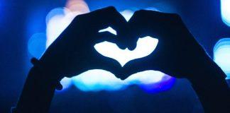 Top 40 List Most Liked Tweets Twitter Social Media Influencers Celebrities Politicians Artists Photos Videos Blue Heart Shape Hand Bokeh Lights Concert