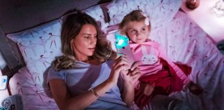 Moonlite Story Time Projector For Smartphones with Reading App Bed Time Sleeping For Kids Girl Looking