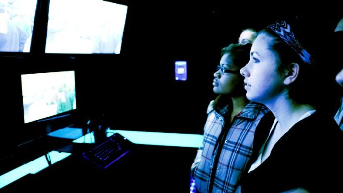 Teenagers-STEM-Project-Learning-Real-Environment-Tech-Education-Course-How-To-Examples-List-Girls-Staring-Screens-Operations-Center