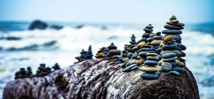 Balance Pebble Pile Building Zen Meditation Blue Ocean Waves Crushing Beach Risk Neutrality Bad Good Chance Opportunity Issue Problem Management Leadership
