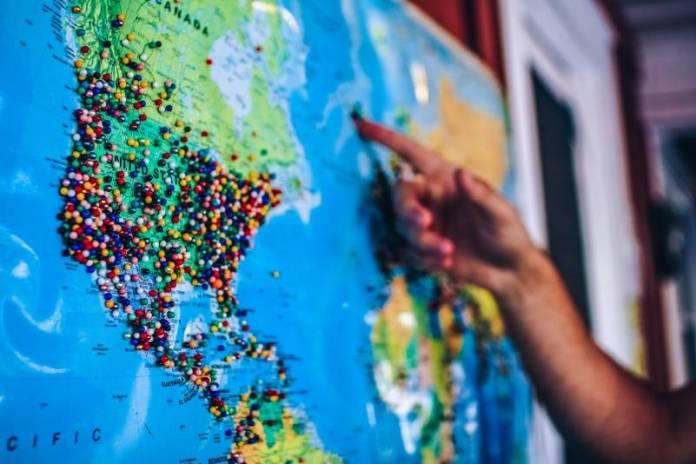 Pinning-Needles-Pins-On-Map-Worldmap-Earth-Destinations-Targets-International-Social-Media