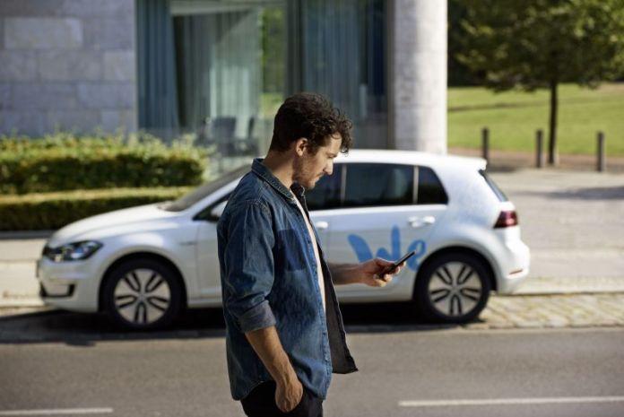 Volkswagen We Booth MWC Barcelona 2019 Man Walking Unlocking Car With Smartphone