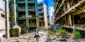 Woman Walking In Ruined City Robotics Future Warfare Military Weaponized AI Article