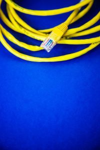 Yellow CAT Cable RJ45 Jack Isolation Blue Background Networks Cloud Edge 5G Technology