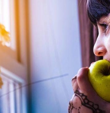 Healthy Lifestyle Woman Eating Biting Apple Green Henna Tattoo Looking Window