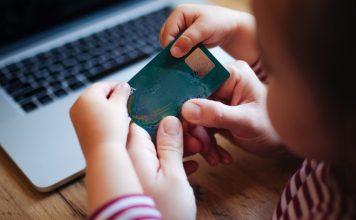 Goalsetter Parenting Cashola Credit Card Debit Financial Literacy Teaching Learning Money Shopping Education Mother Child Laptop Online Ecommerce