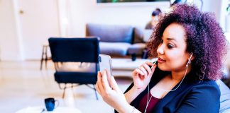Helping Your Small Business Grow via Automation - Woman SMB Meeting Smartphone Purchasing