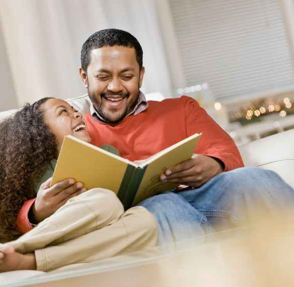 daughter and father reading a picture book
