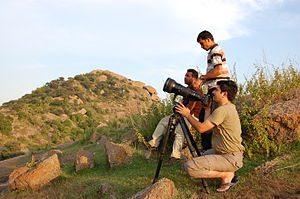 English: Photographers use a Tripod to stabili...