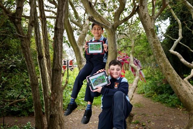 Nikolas Antoniou and Kai Molloy Gaffey of St. Brendan's primary school in Artane, Dublin playing the new Sutainimals video game made in partnership between TU Dublin and Concern Worldwide