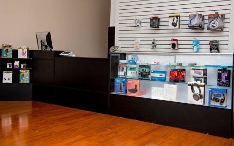 Picture of Tech Corners Showroom Front Counter containing POS machine, service desk and various computer and tech accessories on display.