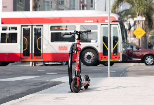 Scoot scooter with new company locks in san francisco. Image by silence.