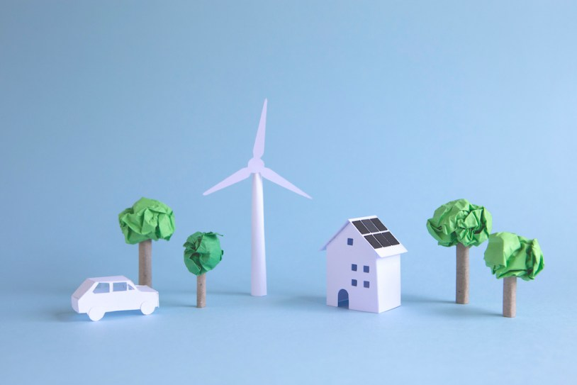Ideal paper world powered with alternative wind and solar energy. environmental concept.