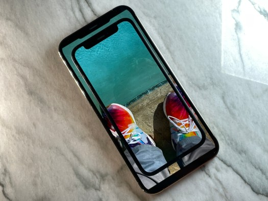 The iPhone 12 mini on top of an iPhone 12 Pro Max