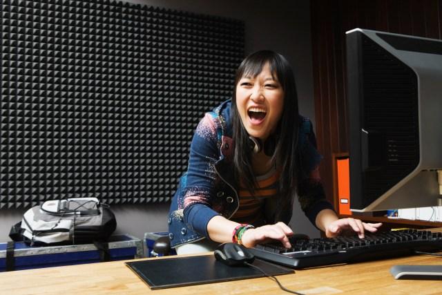 girl playing games on desktop computer