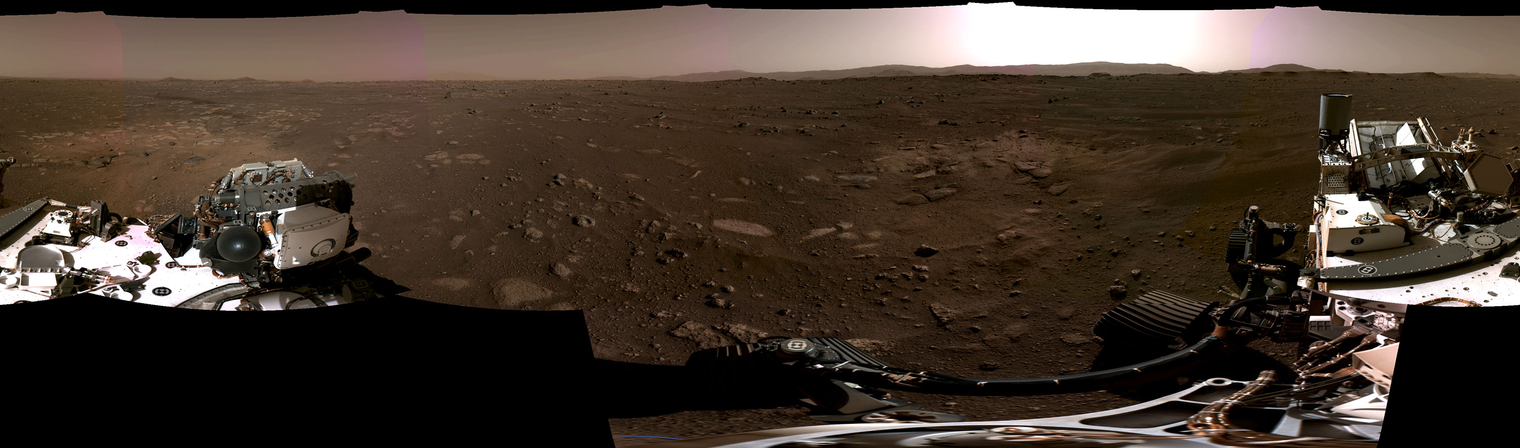 Panoramic image of the Martian landscape and Perseverance rover.