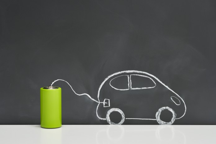 Batteries and electric vehicles on a blackboard