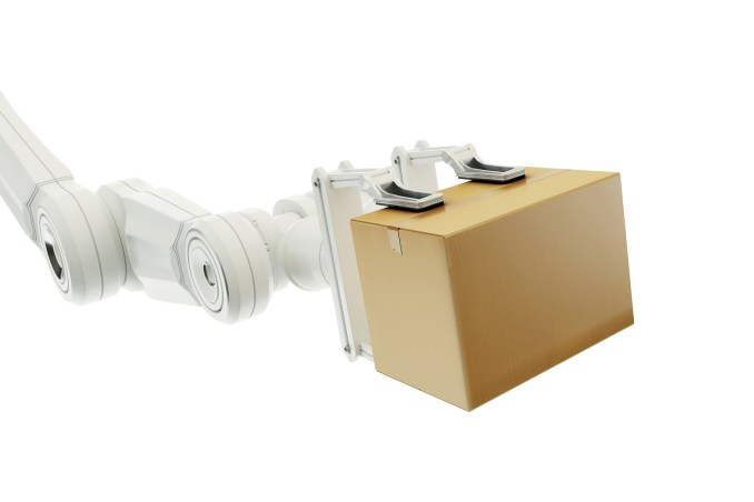 Robot arm holding a cardboard box