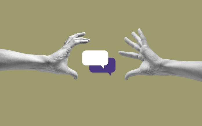 Speech bubbles between two human hands against a khaki background.