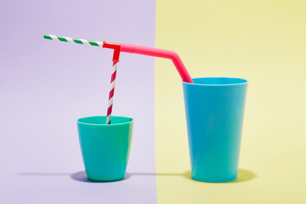 A combination of drinking straws in two cups