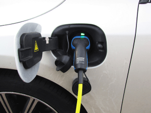 A plug-in electric vehicle being recharged