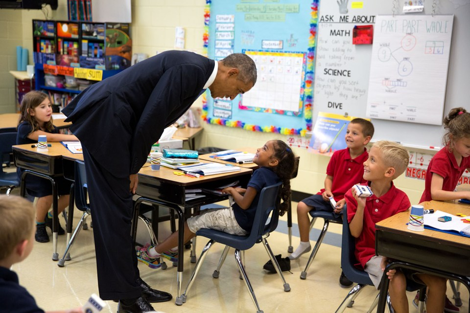 President Barack Obama visits with students in a classroom at Clarence Tinker Elementary School at MacDill Air Force Base in Tampa, Fla., Sept. 17, 2014. (Official White House Photo by Pete Souza) This official White House photograph is being made available only for publication by news organizations and/or for personal use printing by the subject(s) of the photograph. The photograph may not be manipulated in any way and may not be used in commercial or political materials, advertisements, emails, products, promotions that in any way suggests approval or endorsement of the President, the First Family, or the White House.