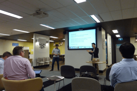 Andrew Bao and Marcus Lim (Lightbulb) pitching their idea of a digital news app to the panel of judges