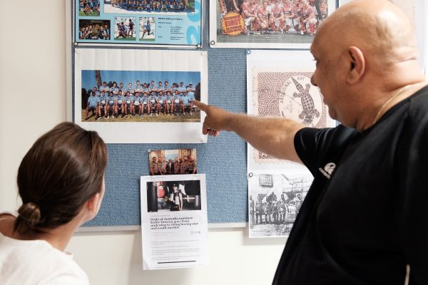 Phil Duncan showing memorabilia. Photo by Mike Catabay for Learning Innovation Hub