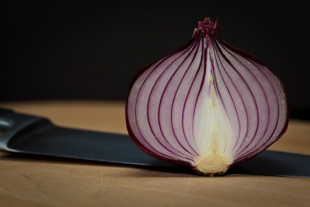 cross-section of sliced onion on chopping board