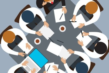 Vector graphic of groupwork at a table viewed from above