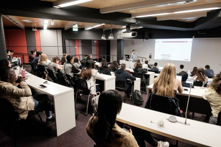 Students in MQ lecture theatre - by Mike Catabay for LIH