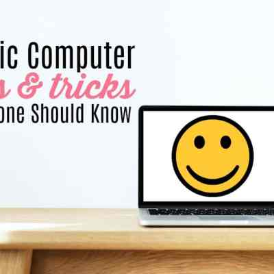 laptop with a smiley face on a desktop