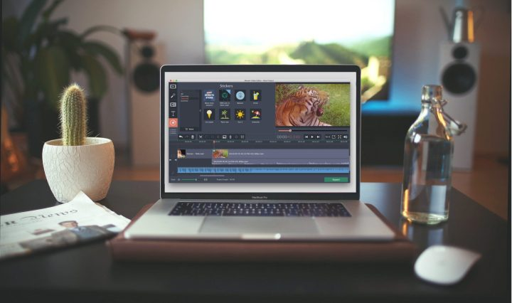 macbook on the table with movavi video editor plus launched