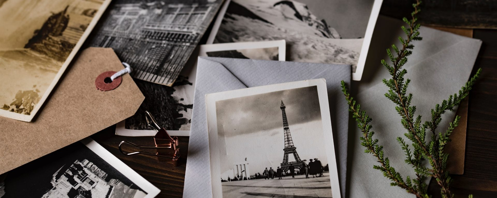 the bunch of photos of eiffel lower on the desk