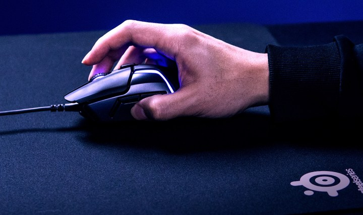 the hand holding steelseries rival 600
