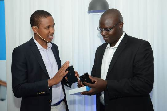 Microsoft Operative Product & Device Manager for East, Central and West Africa, Mr. King'ori Gitahi (Left) and Microsoft Senior Business Manager East and Southern Africa, Mr. Gopher Ogembo confer during the launch of Lumia 950, Lumia 950XL , Lumia 650 and 550 in Nairobi.