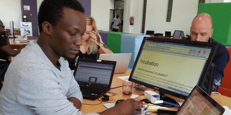 Sam Gichuru busy working