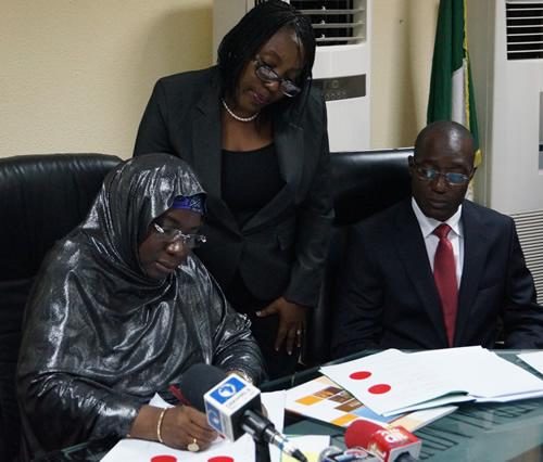 The Honourable Minister of Education Prof. Ruqayyatu Ahmed Rufa'i OON (Left) signs the AVU Charter at the Ministry's offices in Abuja, Nigeria. Looking on is the AVU Rector, Dr. Bakary Diallo (Right). Nigeria becomes the 18th Member State of the AVU. The Honourable Minister of Education Prof. Ruqayyatu Ahmed Rufa'i OON (Left) signs the AVU Charter at the Ministry's offices in Abuja, Nigeria. Looking on is the AVU Rector, Dr. Bakary Diallo (Right). Nigeria becomes the 18th Member State of the AVU.