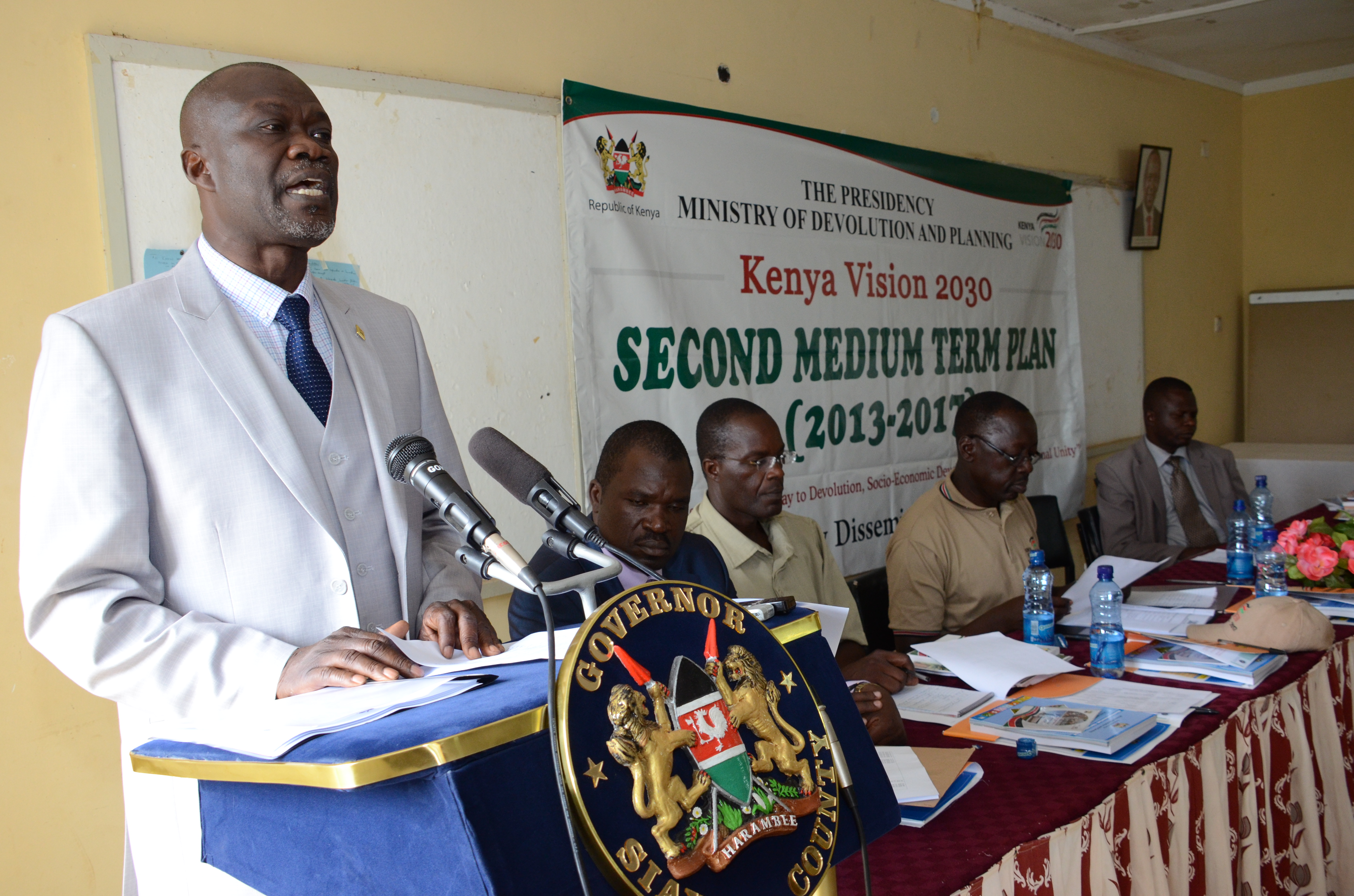 Siaya County Governor Cornell Rasanga during giving his key note address the Second Medium Term Plan dissemination forum at the Siaya Agricultural Training Centre.  The ministry of Devolution and planning is undertaking a countrywide sensitization exercise to strengthen the capacity of county officials on how to make the Vision 2030 a reality.
